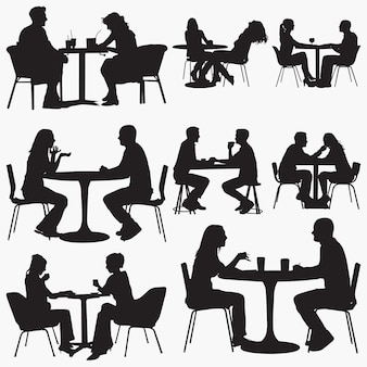 Пара сидит в ресторане силуэты