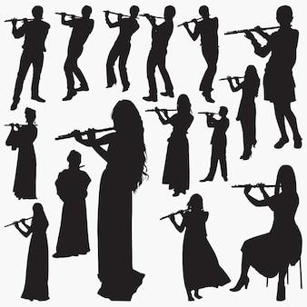 フルートシルエットを演奏する人々