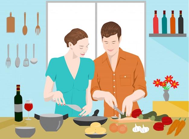 カップルはキッチンで一緒に料理しています