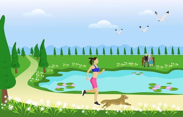 女性と彼女の犬は公園を行く途中でジョギングしています