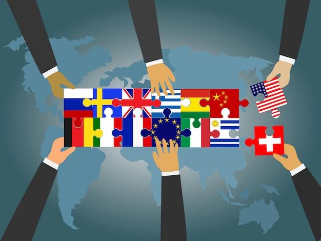 世界中の国々のリーダーが国旗のジグソーパズルを結びつけています。