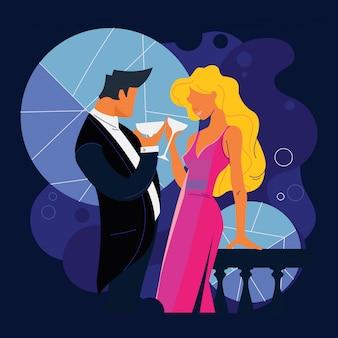 美しいカップルがレストランのバルコニーで歓声を上げる