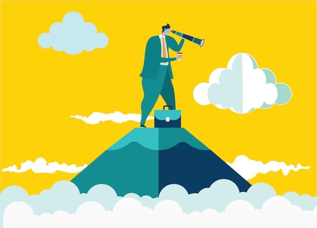 山の上に立っている実業家