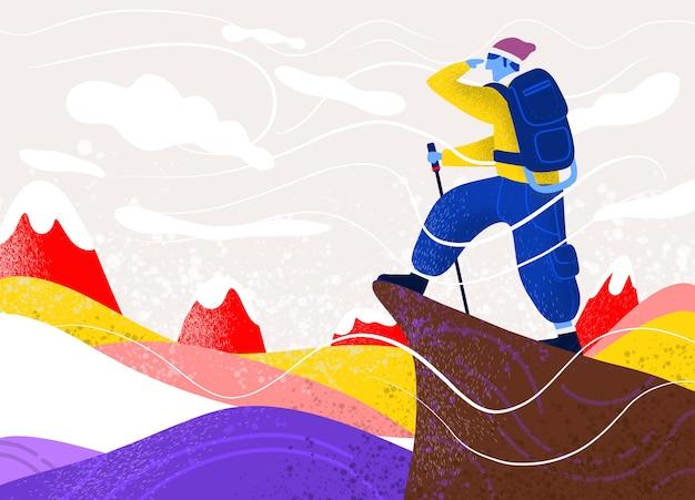 岩の上にバッグを持つ男。極端なアウトドアスポーツ。山に登る。