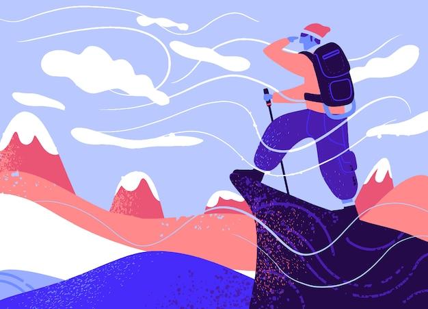 岩の上のバッグを持つ男、極端なアウトドアスポーツ。