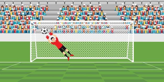 ゴールキーパーはサッカーボールをキャッチするために飛んでいる。