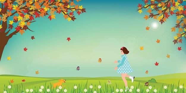 かわいい少女と犬がフィールドに蝶をつかまえています。