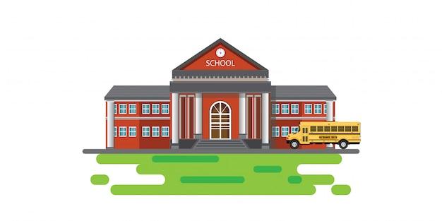 Современное школьное здание со школьным автобусом.