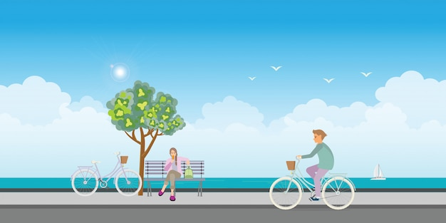 自転車に乗って若い男とアイスクリームを食べる若い女性。