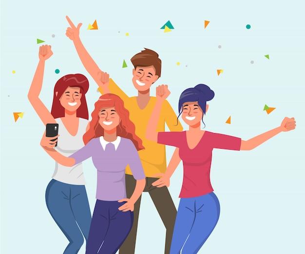 Молодые люди празднуют вечеринку с танцами и селфи вместе в праздник.