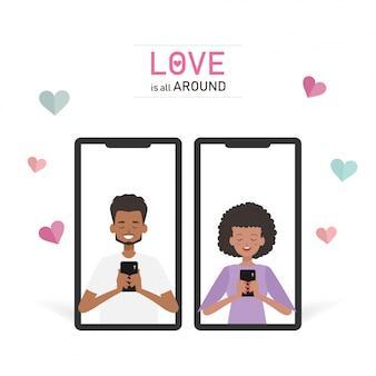 人々はバレンタインデーにスマートフォンを使用しています。