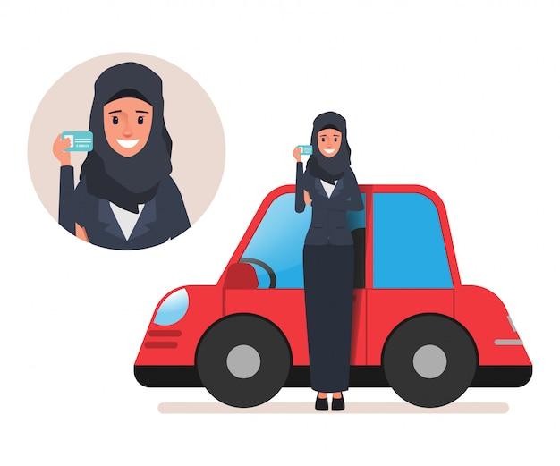 運転免許証と車を持つサウジアラビア人アラブ女性。