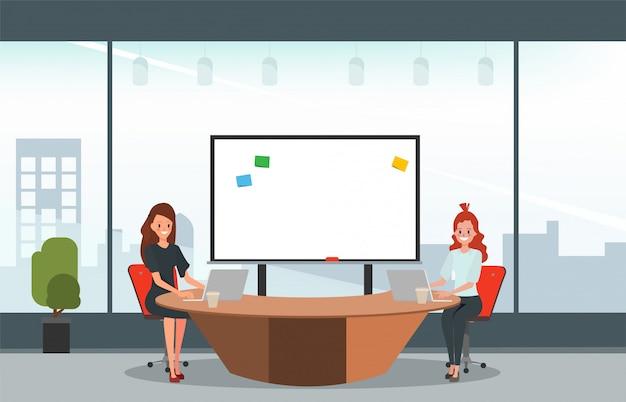 オフィスのインテリアで仕事中の同僚のビジネス人々。