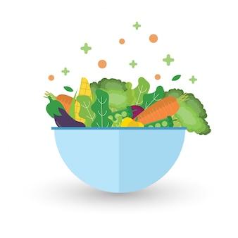Салат с миской. зеленые овощи здоровой пищи.