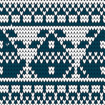ニットの背景。青と白のセーターパターン