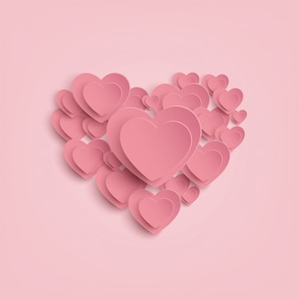 Бумажное сердце на розовом фоне
