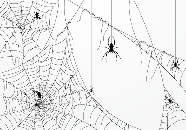 クモの巣で飾られたハロウィーンの背景
