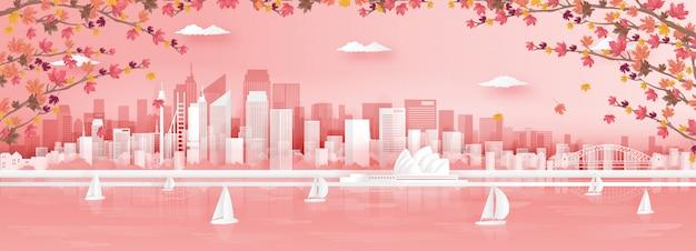 Осенний сезон в сиднее, австралия с горизонтами города и всемирно известной достопримечательностью с падающими кленовыми листьями.