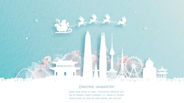 Рождественская открытка с путешествием в сеул, южная корея концепции. милый санта и олени. всемирно известный ориентир в бумаги вырезать стиль иллюстрации.