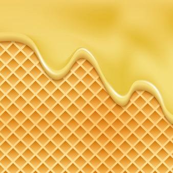 ドリップ蜂蜜ワッフルキャラメル背景。メルトハニーパターンシロップクリームウエハース