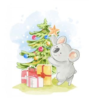 クリスマスツリーの図を飾るかわいいコアラ