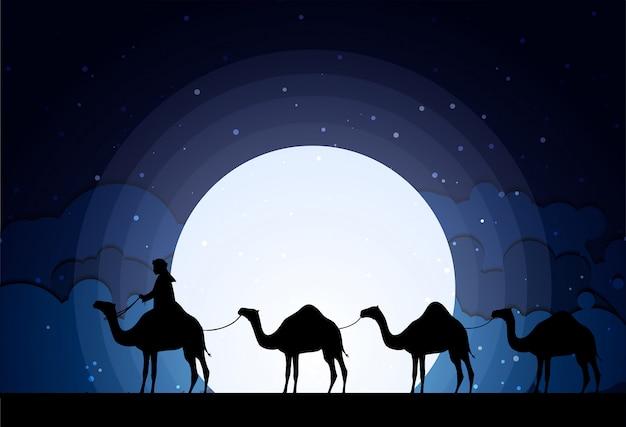 砂漠の夜の月のラクダ
