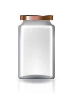 銅の蓋が中程度の大きさのブランクの透明な四角い瓶。