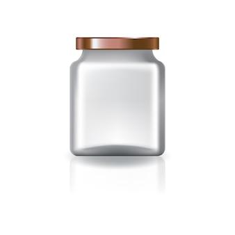 銅の蓋付きの空の透明な四角い瓶。