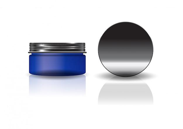 Пустая синяя косметическая круглая банка с черной крышкой.