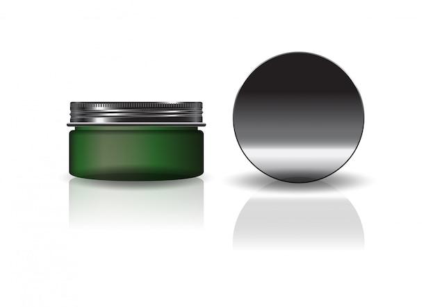 Пустая зеленая косметическая круглая банка с черной крышкой.
