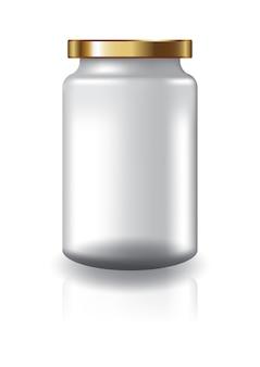 サプリメントや食品用の高サイズの金のふたが付いている空白の透明な丸い瓶。