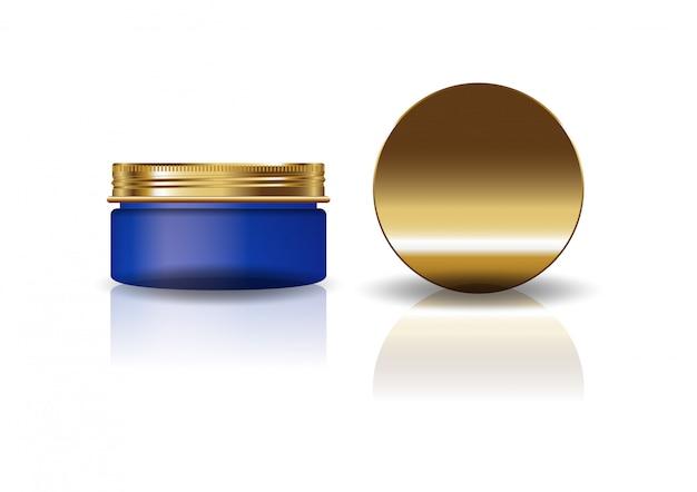 Пустой синий косметический круглая банка с золотой крышкой.