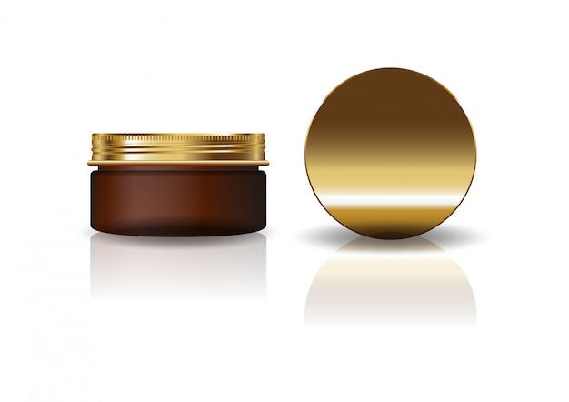 Пустая коричневая косметическая круглая банка с золотой крышкой.