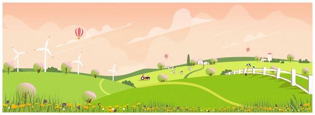 春の田舎の農場。アップルの路地と農家。