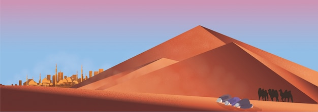 イスラム教徒の男性のパノラマは、砂漠で祈る。