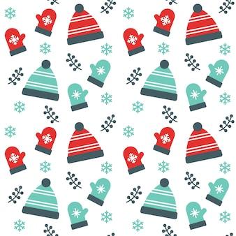 クリスマスビーニーの帽子と手袋シームレスなパターンの背景