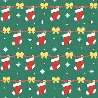 クリスマスソックシームレスなパターンの背景