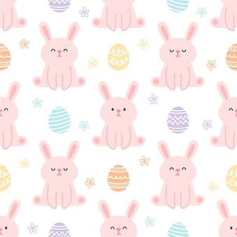 ウサギとイースターエッグのシームレスなパターン背景