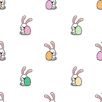 イースターエッグ漫画のシームレスなパターンを持つかわいいウサギ