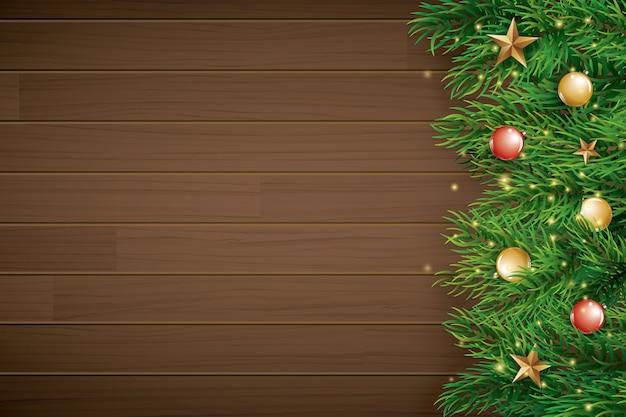 茶色の木製の背景にモミの枝でクリスマス