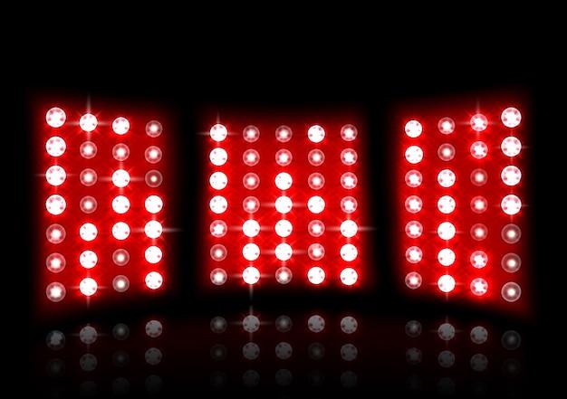 暗い背景にスタジアムの赤い投光器