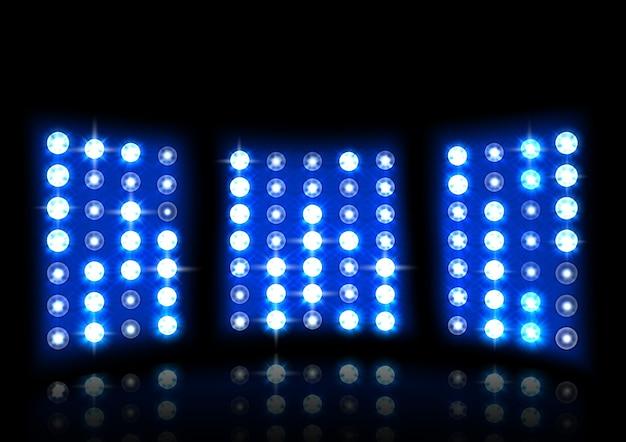 暗い背景に現実的なスタジアムの投光器