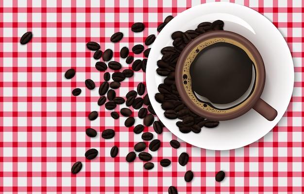 テーブルクロスの背景にコーヒー豆とコーヒーのカップ