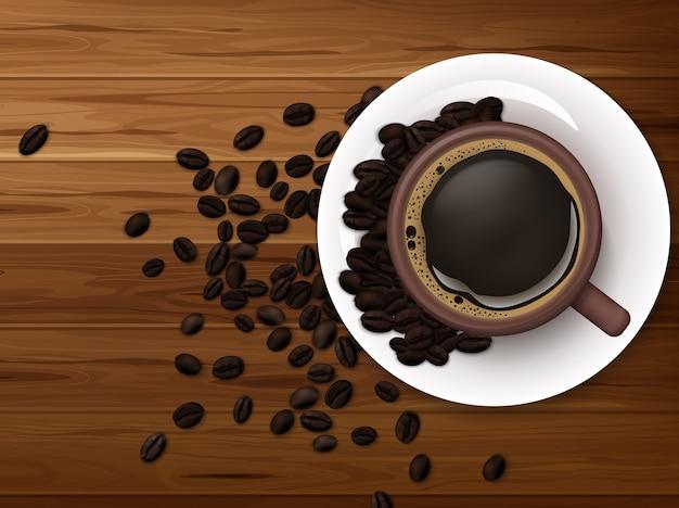 木製の背景にコーヒー豆とコーヒーのカップ