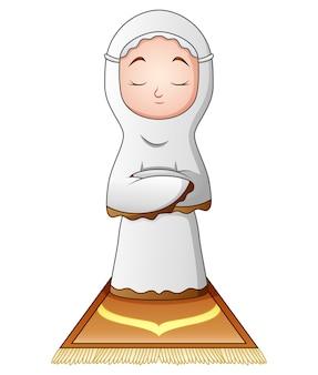 白い背景に祈っているイスラム教徒の女性