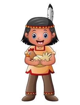 Родной американский индийский мальчик с курицей
