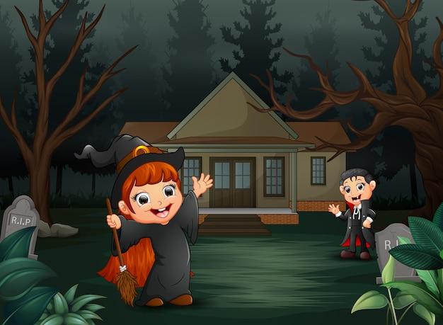 Счастливый хэллоуин с вампиром и ведьмой