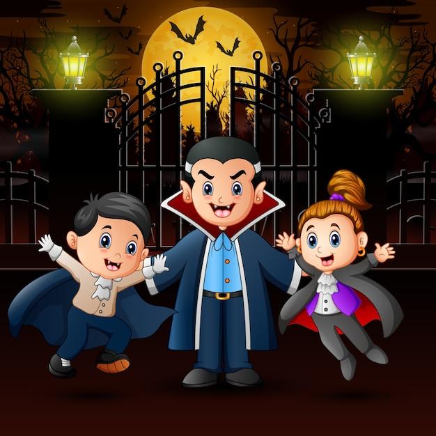 Семья вампиров в день хэллоуина на открытом воздухе в ночное время