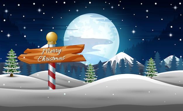 冬の休日の風景木製のサインと夜