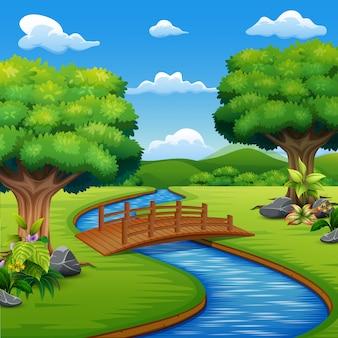 公園の向こう側に橋がある背景のシーン